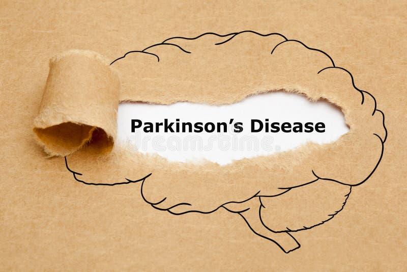 Conceito de papel rasgado doença de Parkinsons fotografia de stock