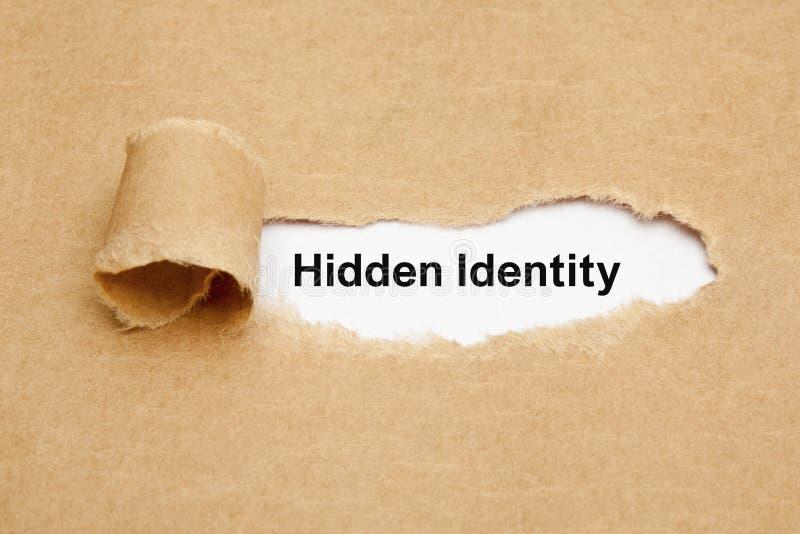 Conceito de papel rasgado identidade escondido imagem de stock