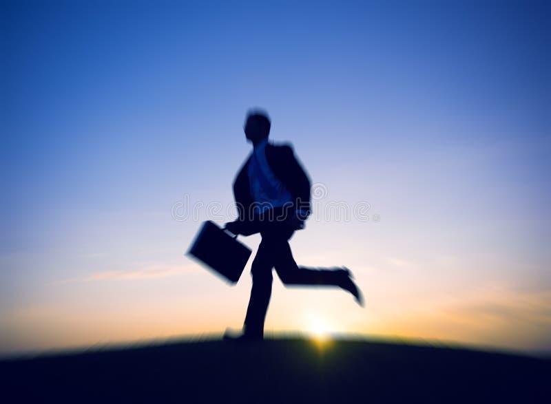 Conceito de Running Rush Hour do homem de negócios imagem de stock