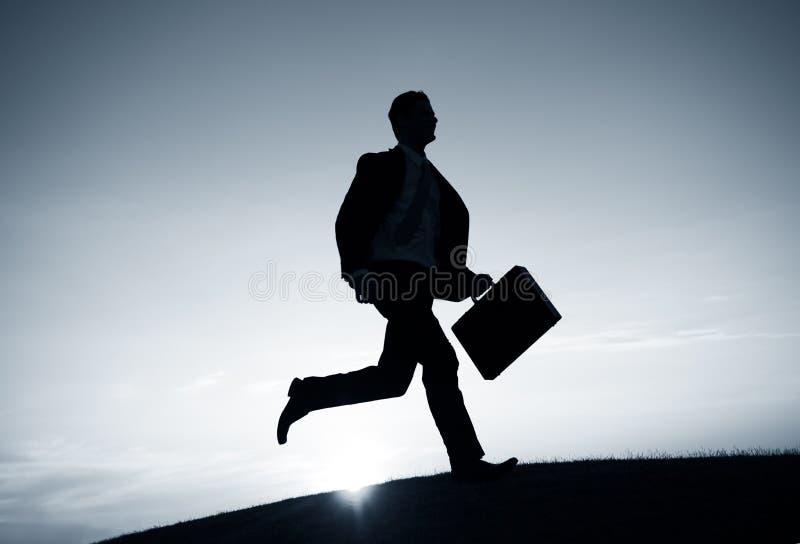 Conceito de Running Rush Hour do homem de negócios imagem de stock royalty free