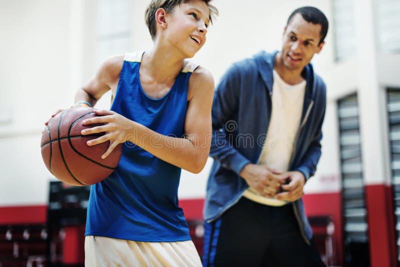 Conceito de Team Athlete Basketball Bounce Sport do treinador imagens de stock