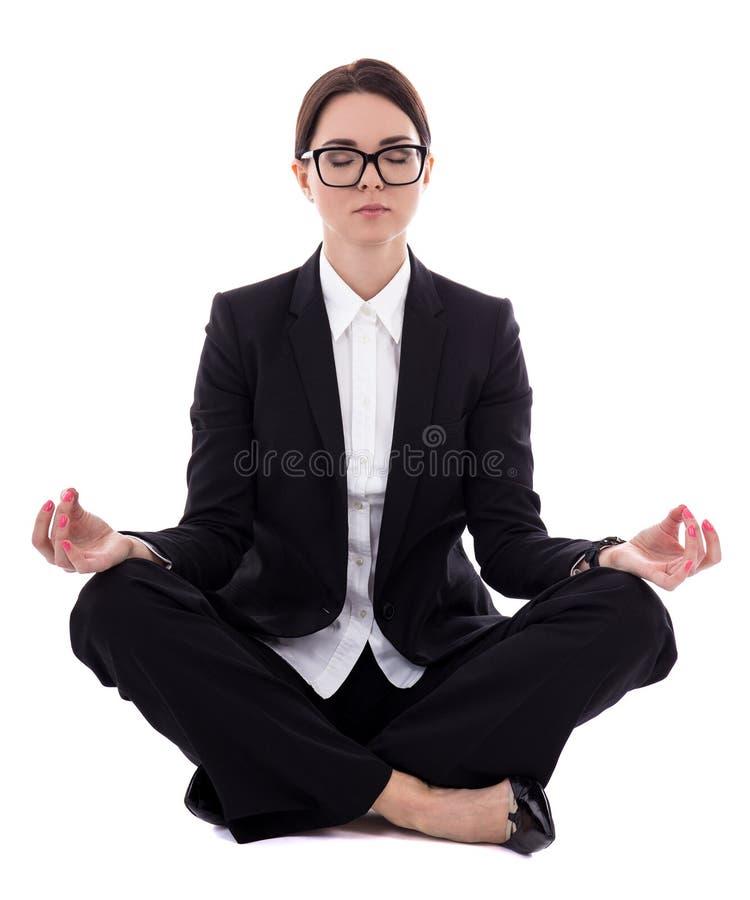 Conceito do abrandamento - mulher de negócio bonita nova que senta-se em y imagens de stock