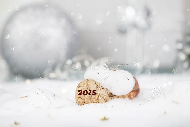 Conceito do ano novo com cortiça e neve do champanhe imagens de stock