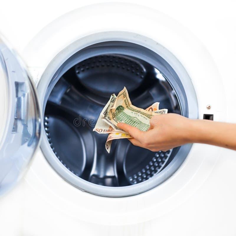 Conceito do crime da lavanderia do dinheiro fotos de stock royalty free