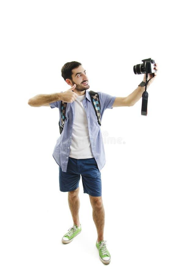conceito do curso Retrato completo do estúdio do comprimento do homem novo considerável que toma o selfie fotos de stock royalty free