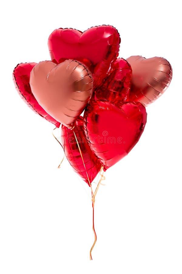 Conceito do dia de Valentim - o grupo do coração vermelho deu forma aos balões isolados no branco fotografia de stock