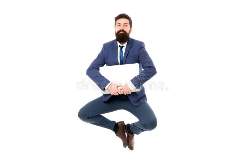 Conceito do equil?brio da vida Inova??es inspiradores O indivíduo inspirado homem de negócios sente calmo Salto calmo do portátil imagens de stock royalty free