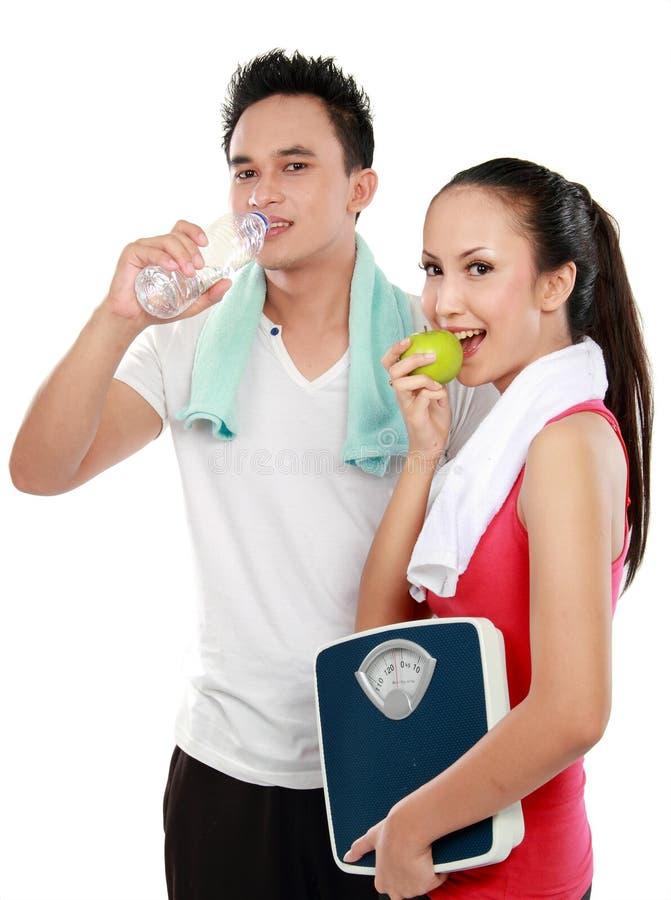 Conceito do homem e da mulher da dieta foto de stock royalty free