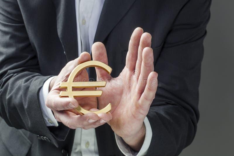 Conceito do homem financeiro que toma da economia europeia fotos de stock royalty free