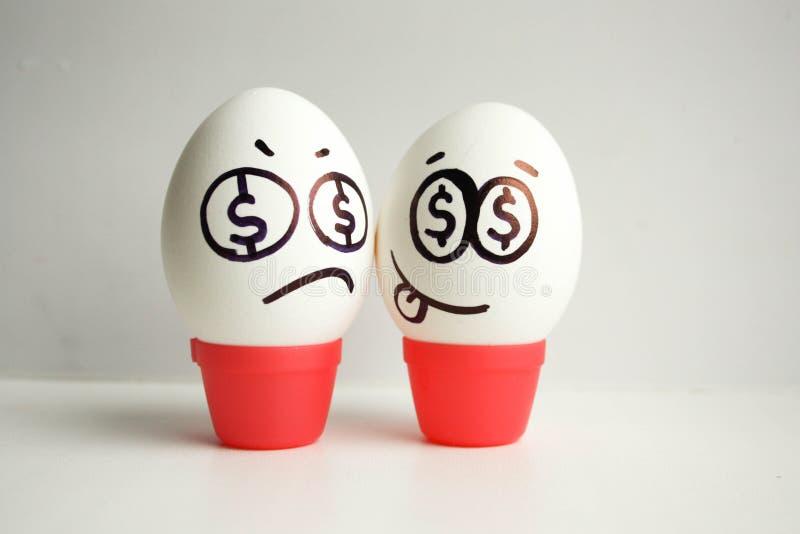 Conceito do negócio betrayal Ovos com pintado imagem de stock royalty free