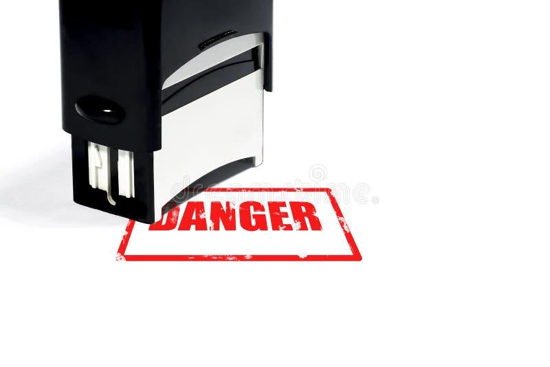 Conceito do perigo, carimbo de borracha com a inscrição em um CCB branco ilustração royalty free