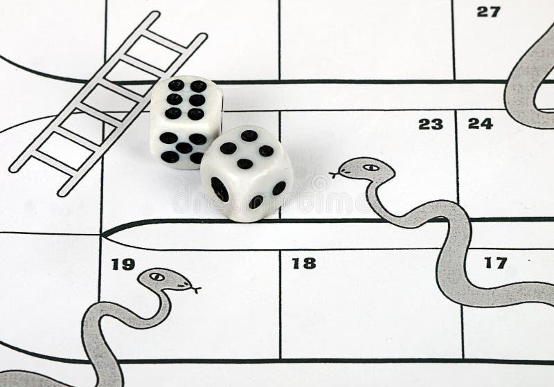 Conceito do risco de negócio - serpentes e escadas fotografia de stock royalty free