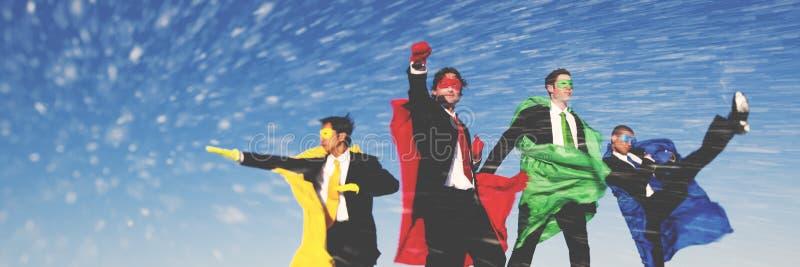 Conceito do salvamento da neve do inverno dos super-herói do negócio foto de stock