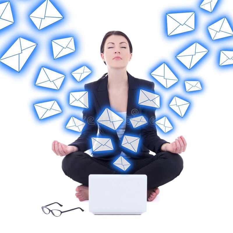 Conceito do Spam - mulher de negócios nova que senta-se na pose da ioga com regaço imagem de stock royalty free