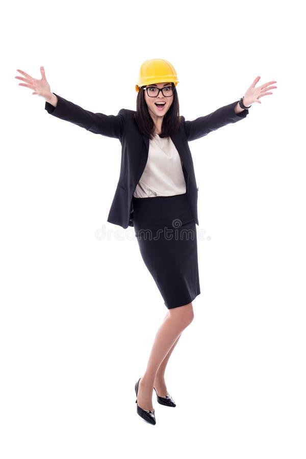 Conceito do sucesso - arquiteto feliz da mulher de negócio no helme amarelo foto de stock royalty free