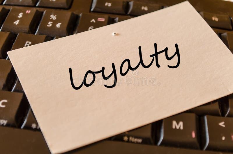 Conceito do texto da lealdade sobre o fundo do teclado imagem de stock