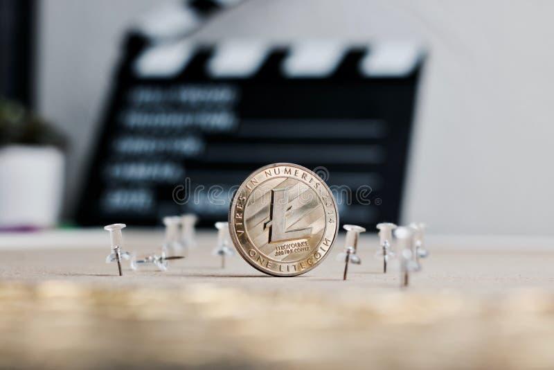 Conceito do vídeo da moeda de Litecoin fotografia de stock royalty free