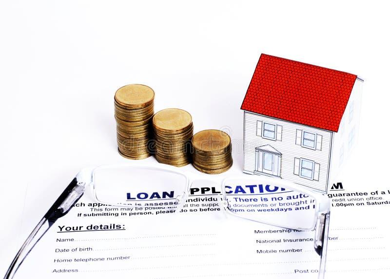 Conceito dos empréstimos hipotecários com fim acima do formulário de pedido de empréstimo e do e fotos de stock royalty free