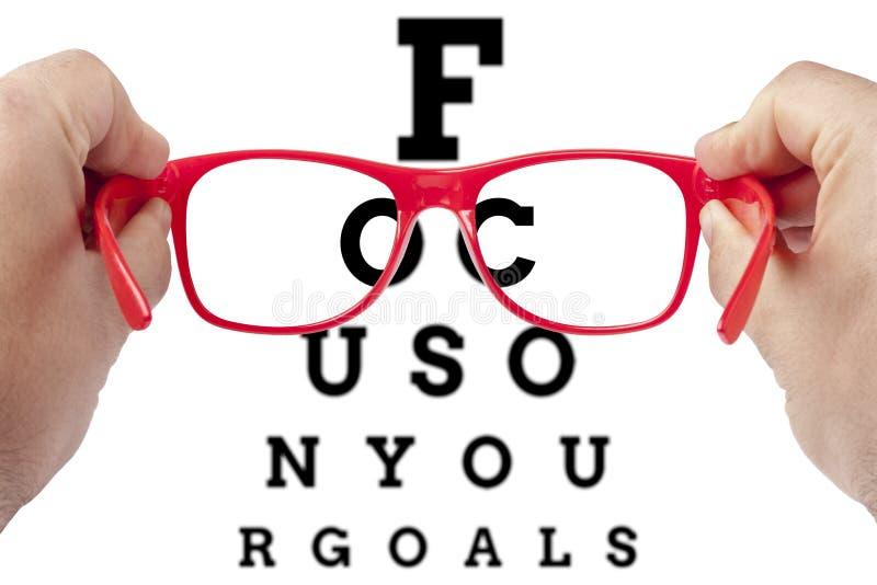 Conceito dos espetáculos dos objetivos do objetivo do foco fotos de stock royalty free