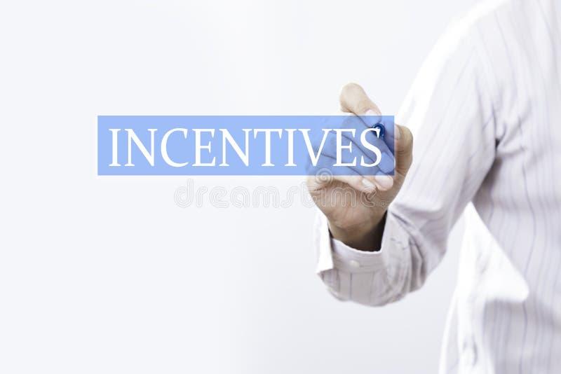 Conceito dos incentivos da tração do homem de negócios fotos de stock