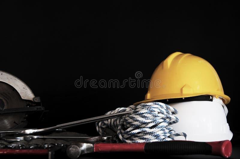 Conceito dos materiais de construção Ferramentas e ferramentas elétricas da mão ferramentas da construção da segurança foto de stock