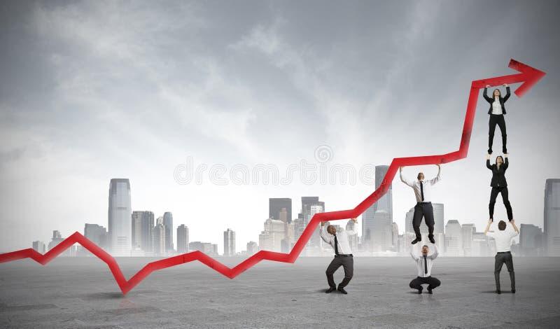 Trabalhos de equipa e lucro incorporado imagens de stock