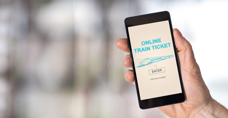 Conceito em linha do bilhete de trem em um smartphone foto de stock royalty free