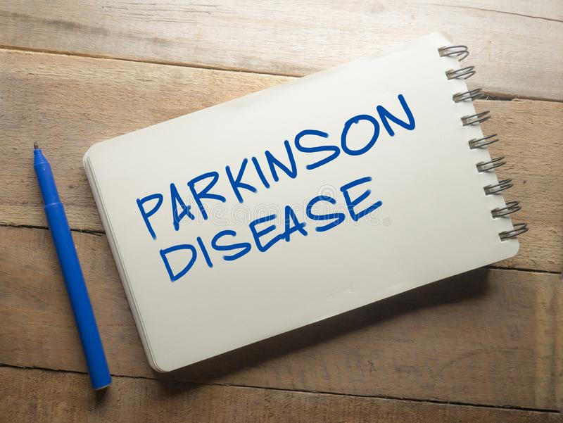Conceito médico e dos cuidados médicos das palavras da tipografia, doença de Parkinson imagem de stock royalty free