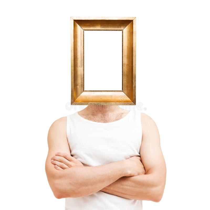 Conceito masculino do narcisismo Homem com quadro dourado fotos de stock