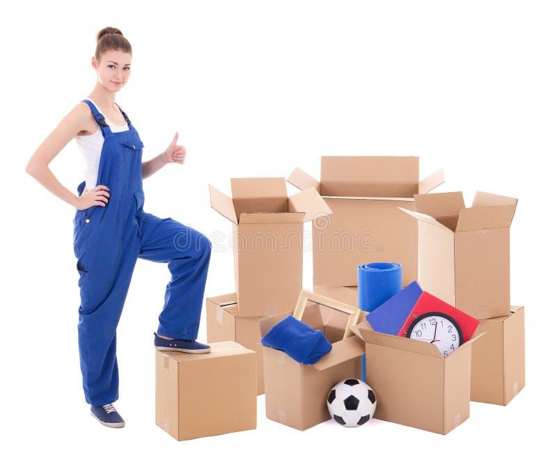 Conceito movente do dia - jovem mulher no workwear azul com cartão fotos de stock