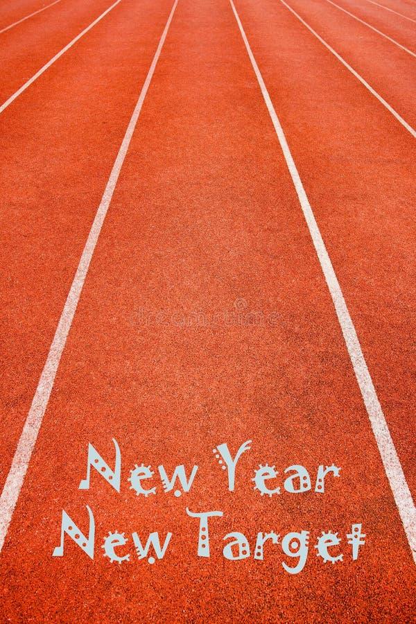 Conceito novo do alvo do ano novo na pista de atletismo imagem de stock royalty free