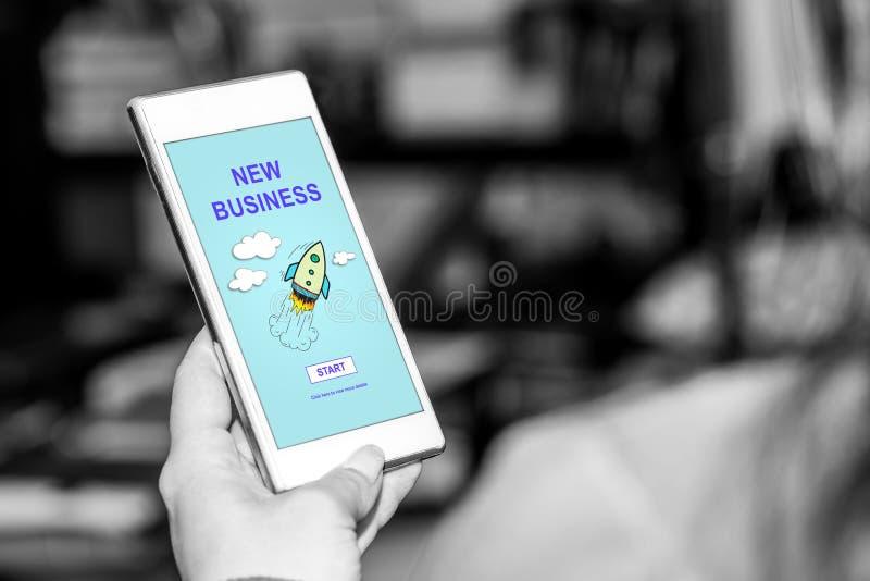 Conceito novo do negócio em um smartphone fotos de stock royalty free
