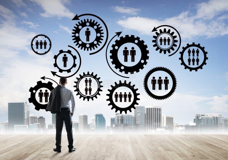 Conceito social da conexão tirado na tela como o símbolo para trabalhos de equipa e cooperação foto de stock
