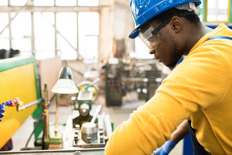 Concentrated African engineer at work stock image