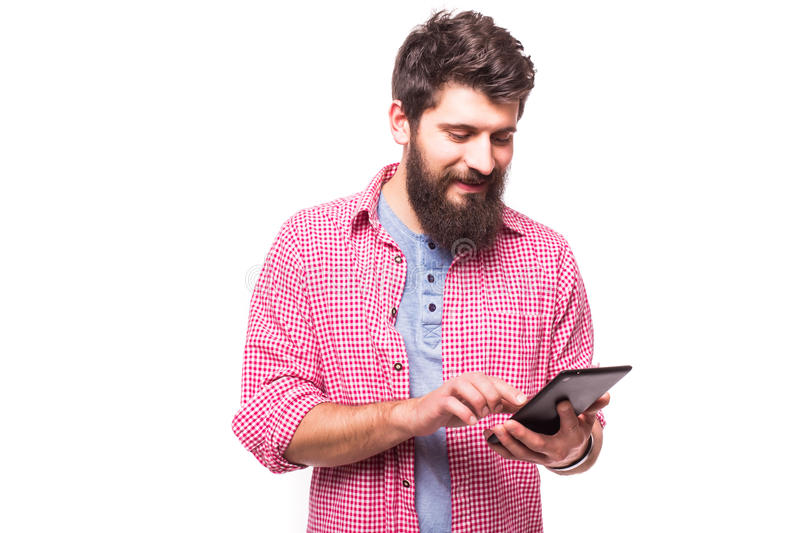 Concentrated bearded hipster man with digital tablet royalty free stock image