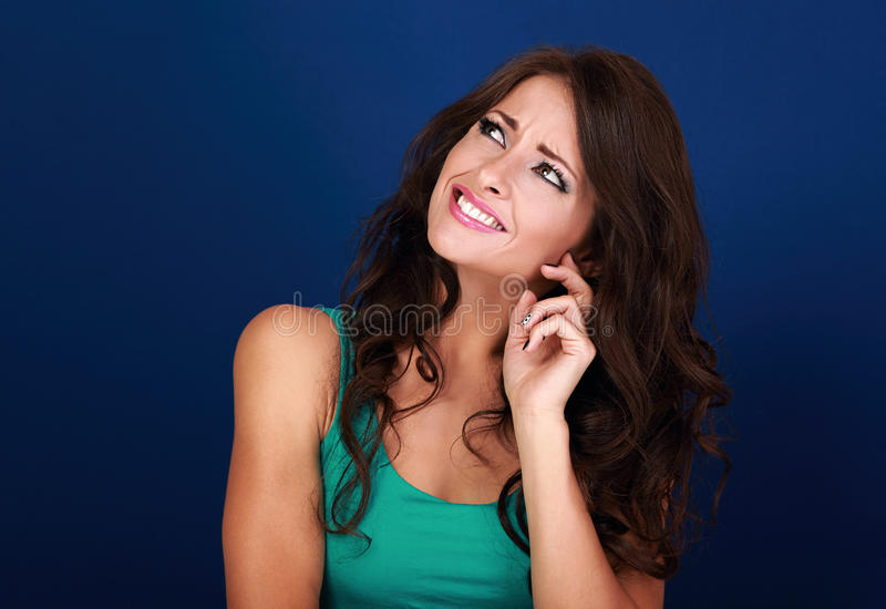 Concentrated beautiful woman thinking and looking up on empty sp royalty free stock photography
