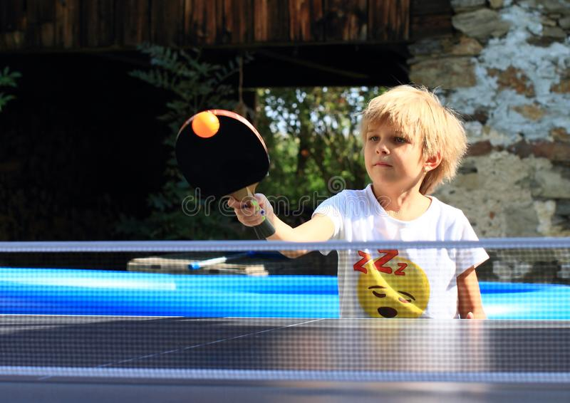 Little girl playing ping-pong royalty free stock photos