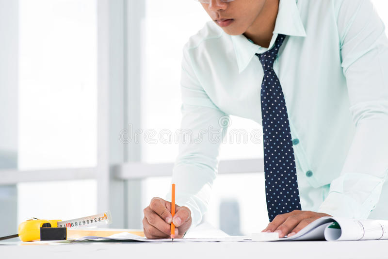 Download Concentrated on blueprint stock image. Image of industry - 28276221