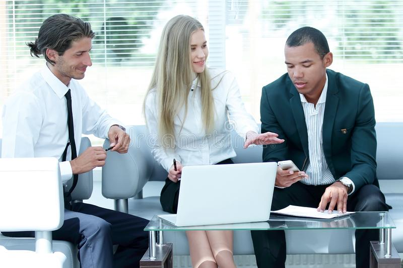 Concentrated business team at the workplace thinking about business problems. Photo with copy space royalty free stock image