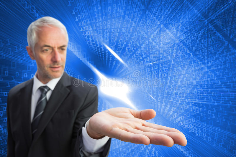 Concentrated businessman with palm up. Composite image of concentrated businessman with palm up stock images