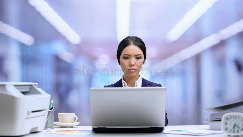 Concentrated businesswoman working laptop in office, corporate career, manager. Stock photo stock image