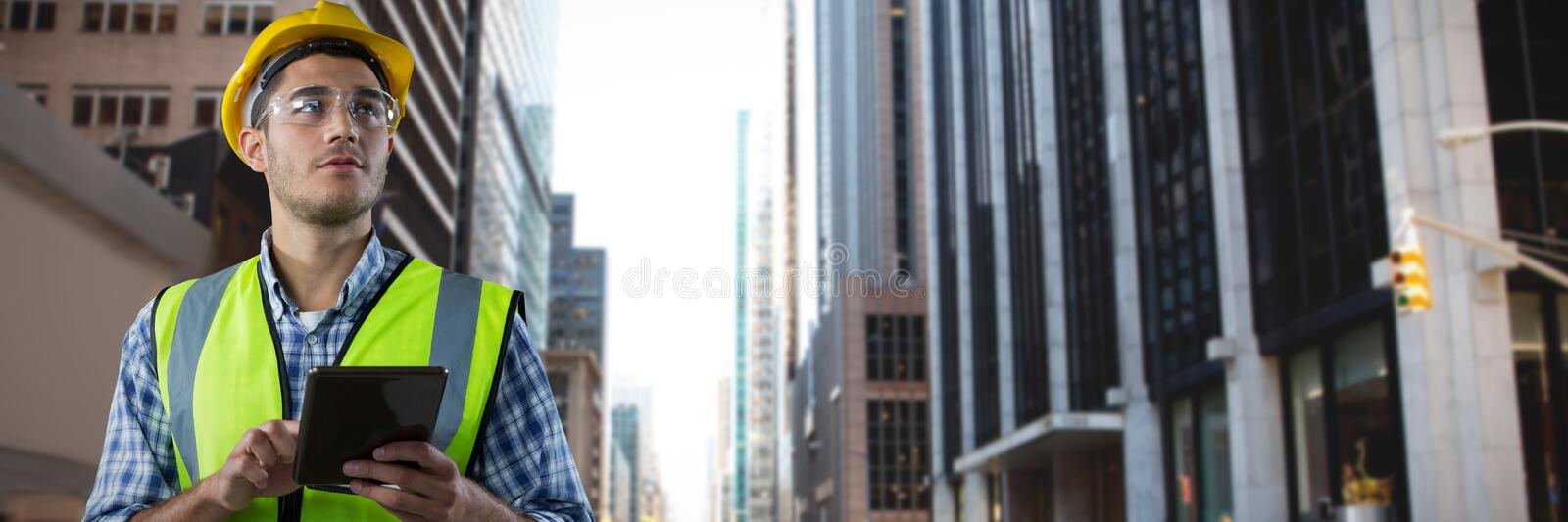 Composite image of concentrated construction worker with tablet royalty free stock photography