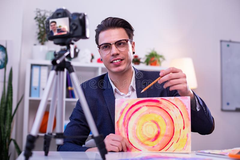 Concentrated dark-haired man in clear glasses and strict jacket royalty free stock images