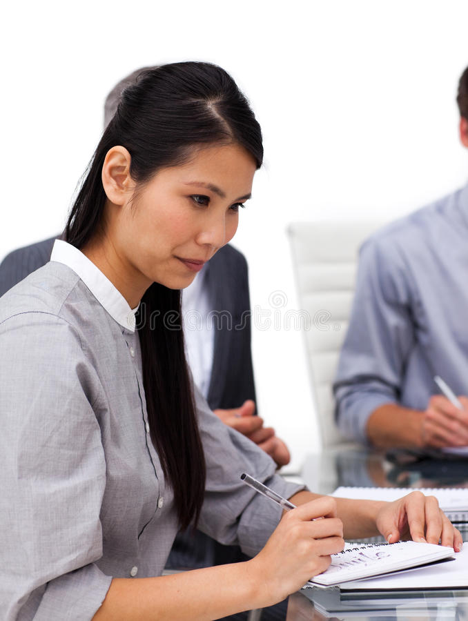 Concentrated female executive studying a document stock photography