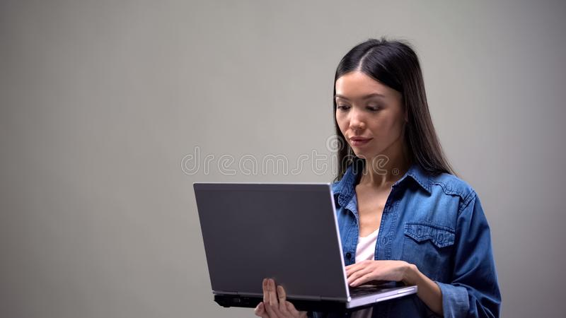 Concentrated freelancer working on computer, job for students, remote work. Stock photo stock photo