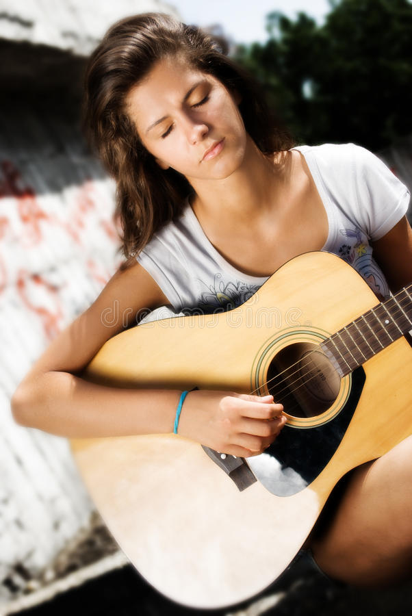 Concentrated Girl, Playing Guitar Royalty Free Stock Photography