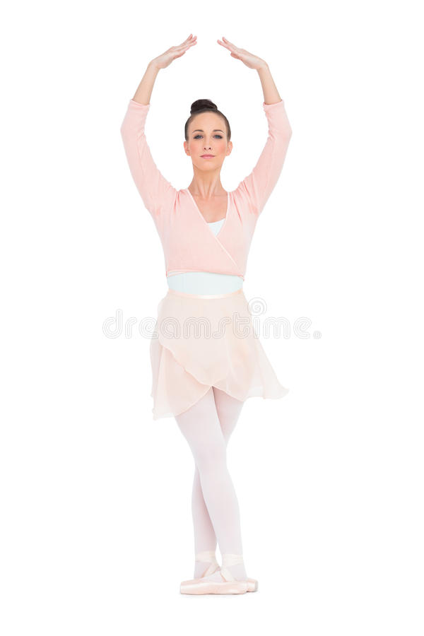 Concentrated gorgeous ballerina standing in a pose royalty free stock images