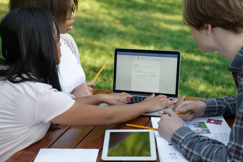Concentrated group of young students royalty free stock photos
