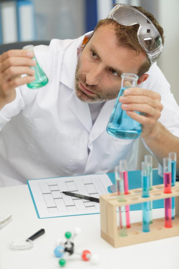 Concentrated lab worker making experiment royalty free stock photos
