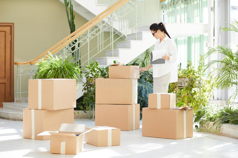 Concentrated lady focusing on inventory stock images